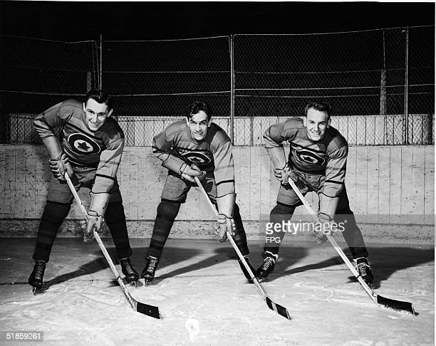 The first forward line of the Canadian Olympic ice hockey team which went on to win the gold at the Fifth Winter Olympics Ab Renaud Ted Hibberd and...