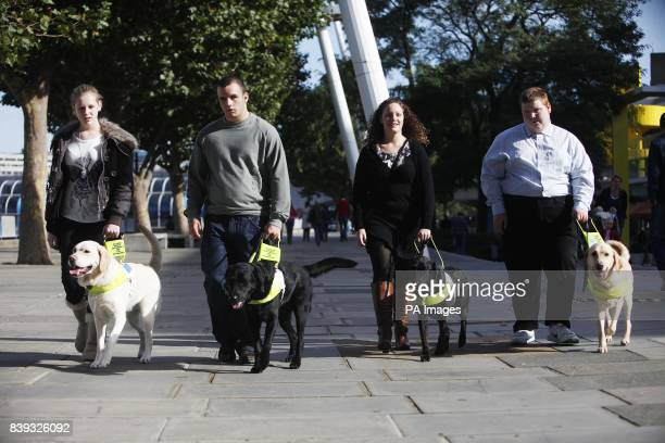 The first four people under sixteen to qualify for a Guide Dog in the UK who were united for the first time on London's Southbank LR Kirsty Meinhardt...