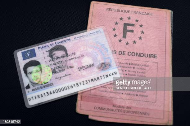 The first French smart card driver's license is pictured next to the former French driving license on September 11 2013 in Paris This secured new...