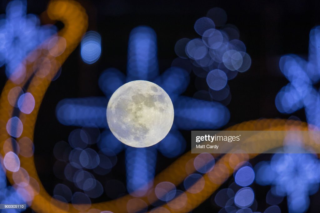 The first full moon of 2018 rises behind festive seasonal lights on display in the High Street in Wells on January 1, 2018 in Somerset, England. Tonight's full moon, which is known by Native American tribes as the 'Wolf Moon', is also a supermoon which means it coincides with the Moon's closest approach to Earth, known as the perigee. Tonights Wolf Moon is the first of two full moons in January. The second will take place on the night of January 31 and in some areas of the world this will also happen at the same time as a total lunar eclipse.