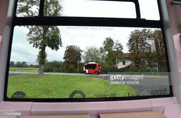 The first German autonomous driving public transport bus drives on a country roa that is part of its new route near to the train station of Bad...