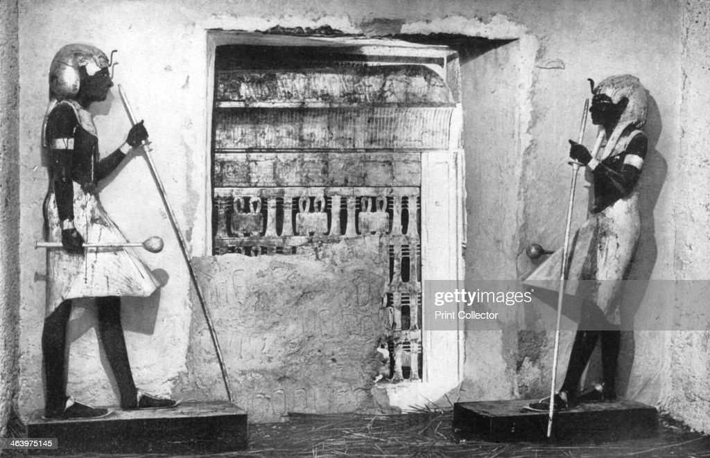 The first glimpse of Tutankhamun's tomb, Egypt, 1933-1934. The sight that met the eyes of Lord Carnarvon and Howard Carter when they broke down the sealed doorway which divided the ante-chamber of the tomb and the sepulchral hall of the departed Pharaoh. The discovery of Tutankhamun's tomb in 1922 by British archaeologist Howard Carter (1874-1939) was one of the most astounding discoveries in archaeology. Tutankhamun was a previously unknown pharaoh whose name had been eradicated from historical records by one of his successors because of his association with the heretical pharaoh Akhenaten, who was Tutankhamun's father-in-law. Consequently his tomb, uniquely, had remained undisturbed by grave robbers. A print from Wonders of the Past, Volume I, 1933-1934.