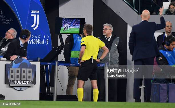 The first goal of Christiano Ronaldo of Juventus is decided using VAR technology by referee Clement Turpin during the UEFA Champions League Quarter...