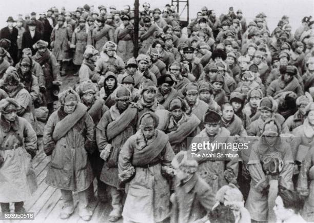 The first group of Japanese prisoners of war in Siberia repatriate on a ship from Nakhodka at Maizuru Port on December 8, 1946 in Maizuru, Kyoto,...
