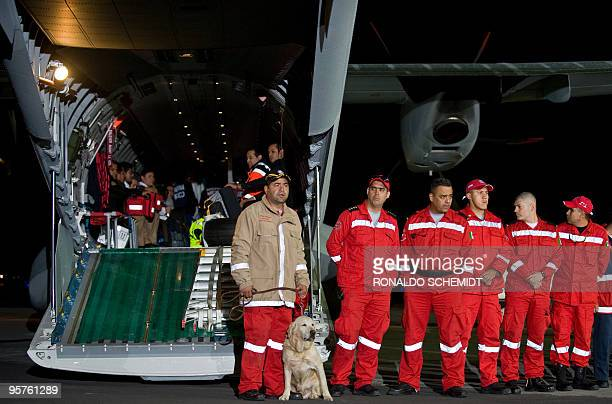 The first group of Mexican disaster relief personnel along with sniffer dogs prepare to depart Mexico city for Haiti on January 13 2010 Rescuers...