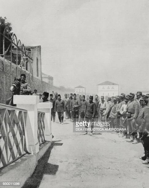 The first group of Turkish prisoners arriving in Rhodes Greece ItalianTurkish war photograph by A Vetta from L'Illustrazione Italiana Year XXXIX No...