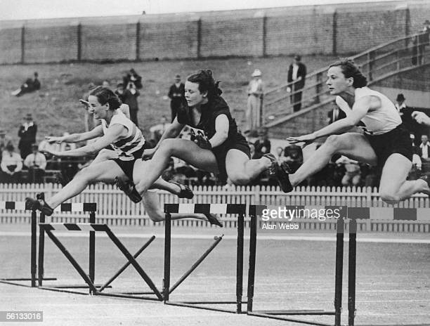 The first heat of the 80 metres hurdles at the British Empire Games in Sydney, 24th February 1938. From left to right, England's Ethel Raby, South...