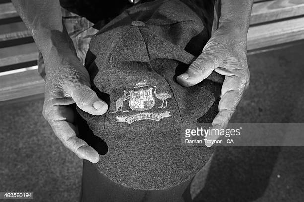 The first indigenous woman to play Test Cricket for Australia Faith Thomas holds her 'baggy green' cap on February 12 2015 in Alice Springs Australia