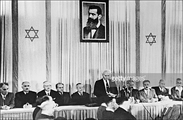 The first Israeli Prime minister David Ben-Gurion , surrounded by the members of the National Jewish Council, at 6.01 pm 14 May 1948 in Tel Aviv...