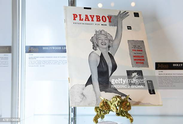 The first issue of Playboy magazine with Marilyn Monroe on the cover and signed by Hugh Hefner on page three is displayed at Julien's Auction House...
