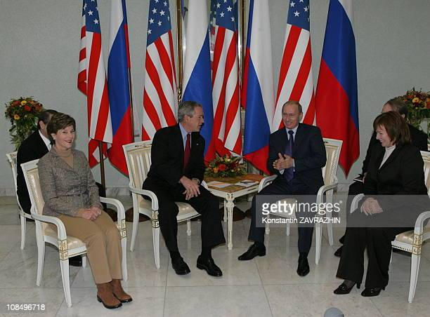 The first lady Laura Bush US President George W Bush Russia's President Vladimir Putin Putin's wife Lyudmila Putina meet during a refueling stop at...