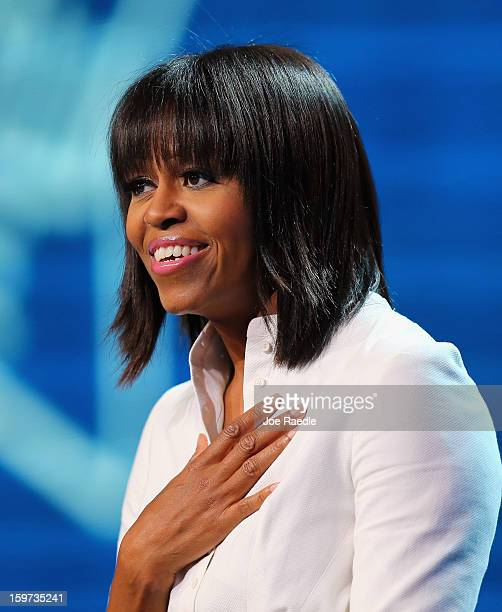 The First Lady Michelle Obama speaks during the children's concert at the Washington Convention Center to celebrate military families on January 19...