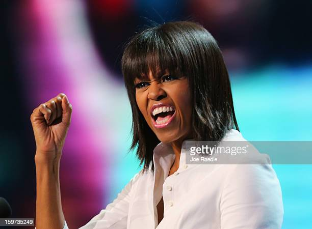 The First Lady Michelle Obama speaks during the children's concert at the Washington Convention Center to celebrate military families on January 19,...