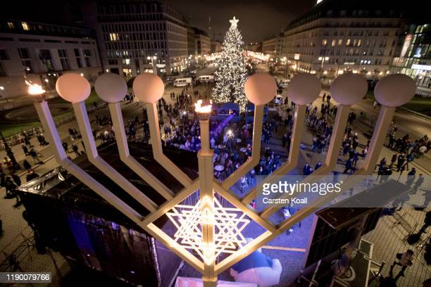 The first lamp of a large scale menorah in front of the Brandenburg Gate burns after it was lit by Rabbis Yehuda Teichtal and Josef Schuster,...
