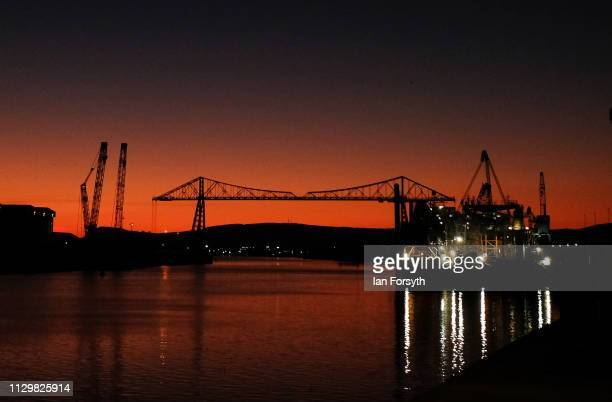 The first light of day rises behind the Tees Transporter Bridge on February 15 2019 in Middlesbrough England The Tees Transporter Bridge often...