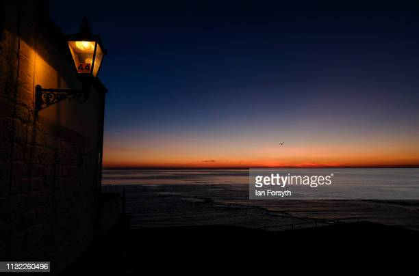 The first light of day rises over Robin Hood's Bay on February 26 2019 in Robin Hood's Bay England Warm weather continues to sweep the country as the...