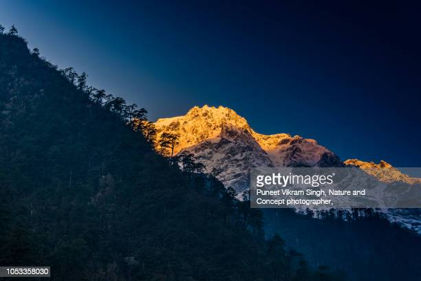 The first light of Sunrise glowing over Himalayan Peak in Sikkim