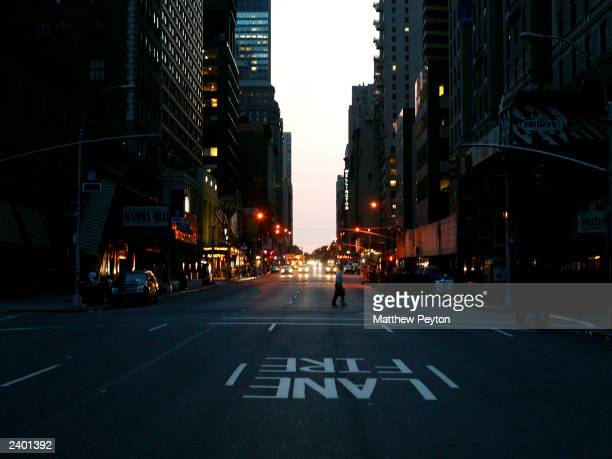The first lights come on at 53rd and Broadway during the east coast blackout August 15, 2003 in New York City.