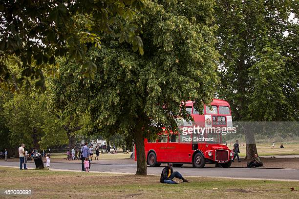 The first London Routemaster bus to come into service RM1 is driven through Finsbury Park during a gathering of the buses to celebrate the 60th...