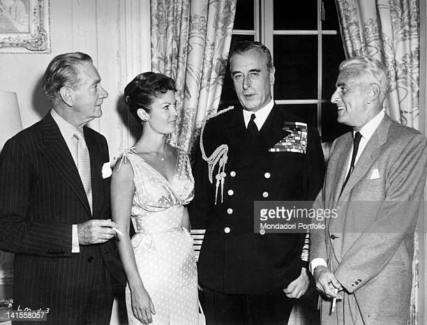 The First Lord of the Sea and member of the English Royal House Lord Mountbatten taking part in a party for him in Hollywood along with the actors...
