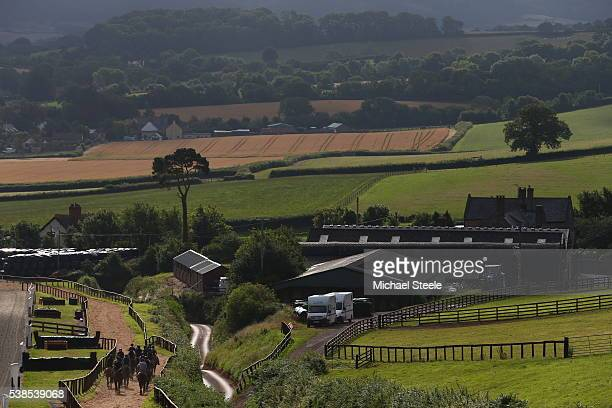 The first lot head back to the yard at Sandhill Racing Stables on July 22 2015 in Minehead England Sandhill Racing Stables set in 500 hundred acres...