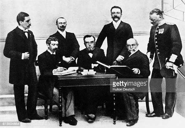 The first meeting of the International Olympic Committee, organized for the 1896 Olympic Games. They are, from left to right, Willabald Gebhardt of...