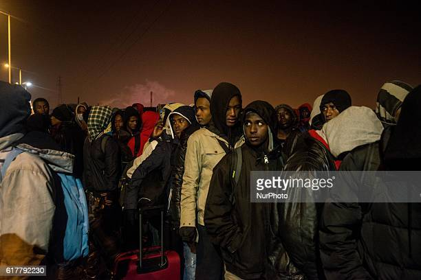 The first migrants doing the queue to take the bus to be accomodated in a center in France Around 7 o clock in the morning the first migrants arrived...