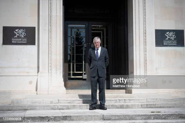 The First Minister of Wales Mark Drakeford observes a 2minute silence outside the Welsh Government building on May 08 2020 in Cardiff United Kingdom...