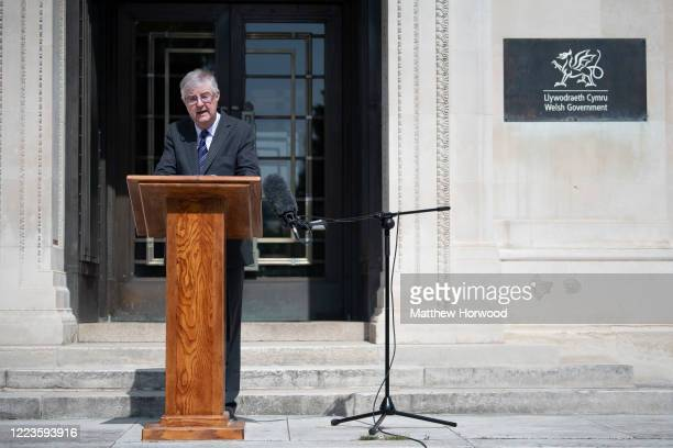 The First Minister of Wales Mark Drakeford speaks to the press ahead of a 2minute silence outside the Welsh Government building on May 08 2020 in...