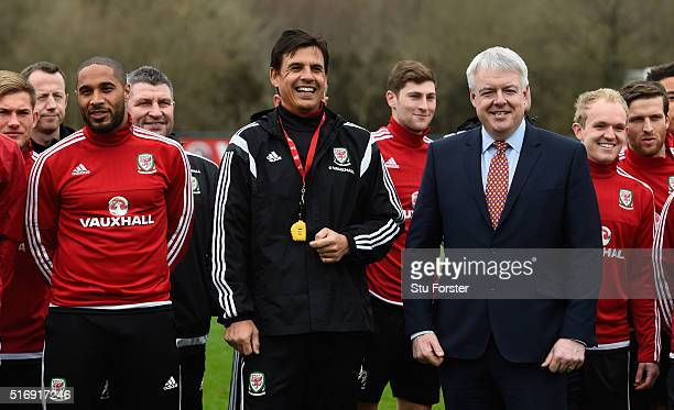 The First Minister of Wales the right honourable Carwyn Jones pictured with Wales head coach Chris Coleman captain Ashey Williams and the Wales team...
