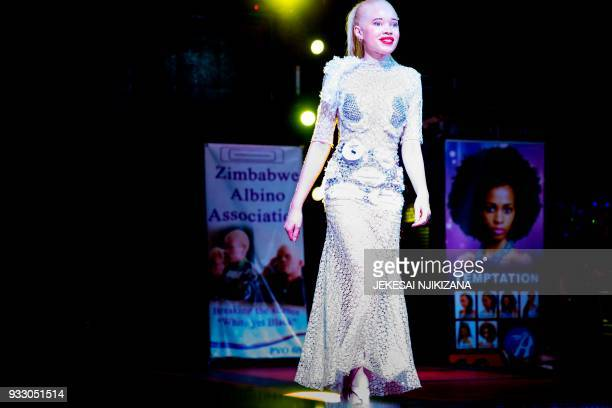 The first Miss Albino Sithembiso Mutukura walks on the catwalk during the inaugural Miss Albino beauty pageant hosted in Harare March 17 2018 Exuding...