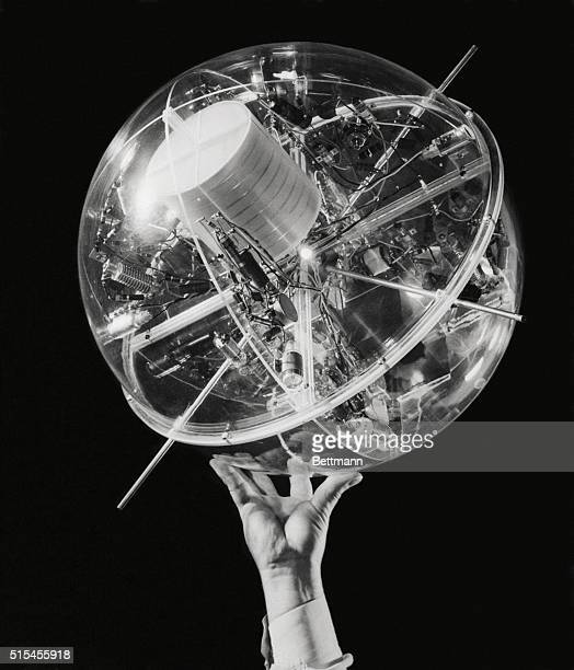 The first model of a man-made earth satellite goes on view, December 20th, at the American Museum-Hayden Planetarium in New York. The full-scale...