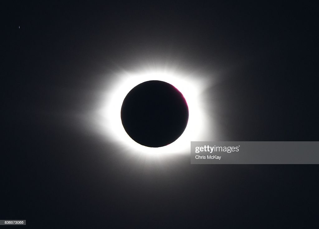 The first moments of totality with Baily's Beads on the upper left of the shadow of the moon as it crosses the sun during The Great American Total Solar Eclipse on August 21, 2017 at Sesquicentennial State Park in Columbia, South Carolina.