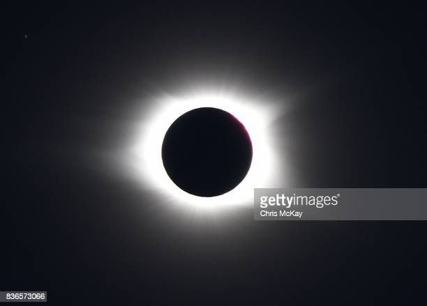 The first moments of totality with Baily's Beads on the upper left of the shadow of the moon as it crosses the sun during The Great American Total...