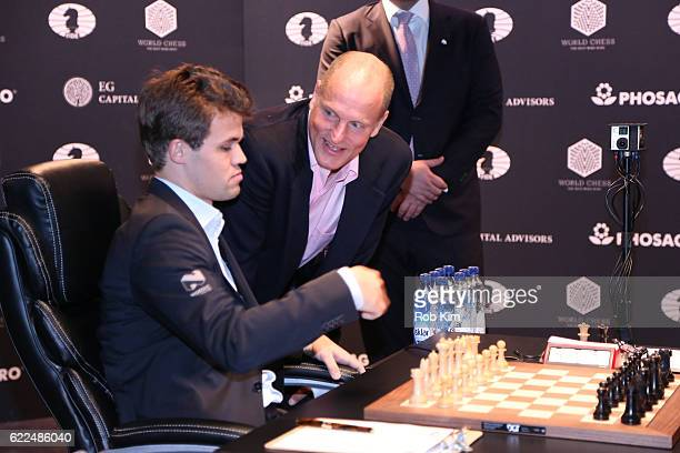 The first move for Reigning Chess Champion Magnus Carlsen against Chess grandmaster Sergey Karjakin is made by Actor Woody Harrelson during 2016...