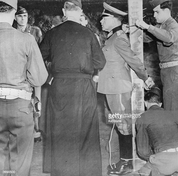 The first Nazi General to be executed Anton Dostler is tied to a post in Aversa to face a US Army firing squad He was tried by an American military...