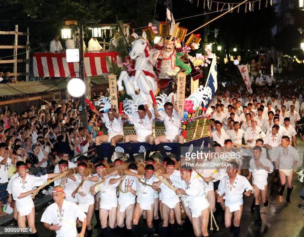The first Nishi Nagare members runs with float called 'Yamakasa' during the 'Oiyama' race through Seido Street of Kushidajinja Shrine during the...