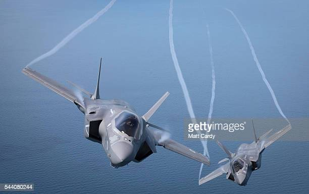 The first of Britain's new supersonic 'stealth' strike fighters accompanied by a United States Marine Corps F35B aircraft flies over the North Sea...