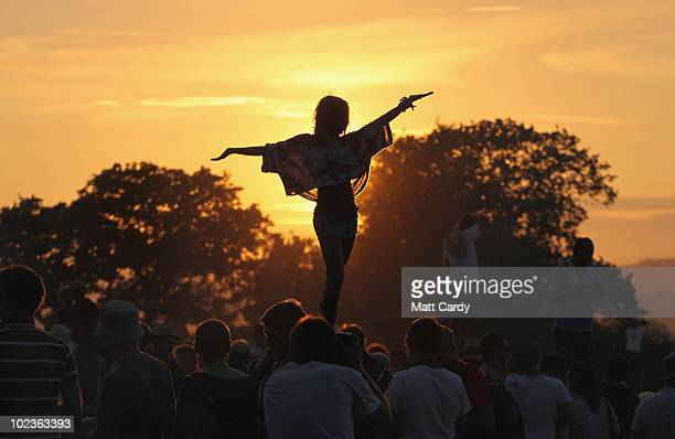 The first of the 140000 music fans due at this year's Glastonbury Festival enjoy the sunset at Worthy Farm Pilton on June 23 2010 in Glastonbury...