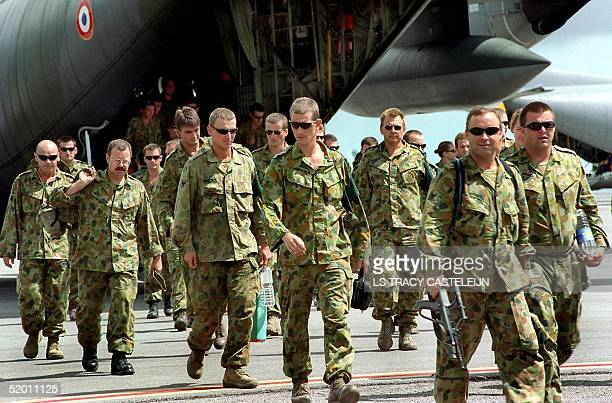 The first of the INTERFET troops returning home to Australia disembark at RAAF Base Darwin 03 December after their stint in East Timor The Australian...