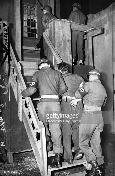 The first of three Germans to be hanged for the murder of a baledout American airman Kohn is led up the 13 steps to the gallows by military police