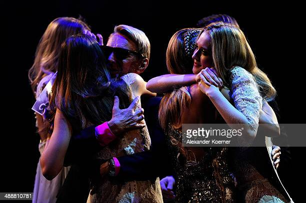 The first of three models Ivana Teklic cheers with model Heidi Klum while Stefanie Giesinger cheers with Wolfgang Joop after the dismissal of Ivana...