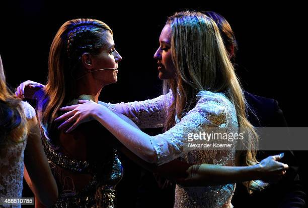 The first of three models Ivana Teklic cheers with model Heidi Klum after being dismissed by the jury and presenter Heidi Klum during the final of...