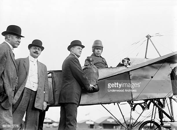 The first official airmail flight in the United States with pilot Earle Lewis Ovington in a Bleriot XI airplane receiving a bag of mail from US...
