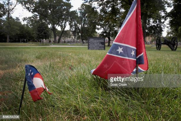 The first official flag of the Confederacy and a Confederate Navy Jack flag sit at the base of Confederate Mound a memorial to more than 4000...