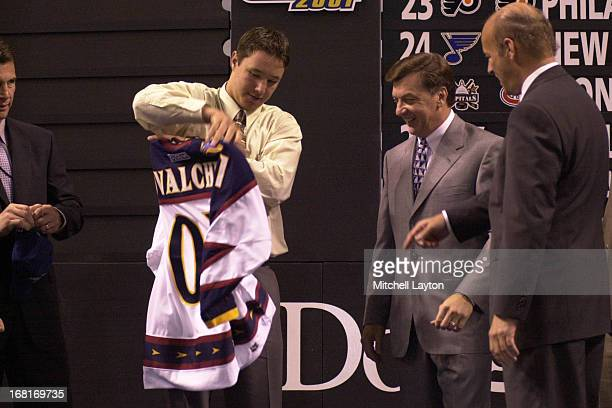 The first overall pick Ilya Kovalchuk of the Atlanta Thrashers receives his jersey during the 2001 NHL Entry Draft on June 23 2001 in Sunrise Florida
