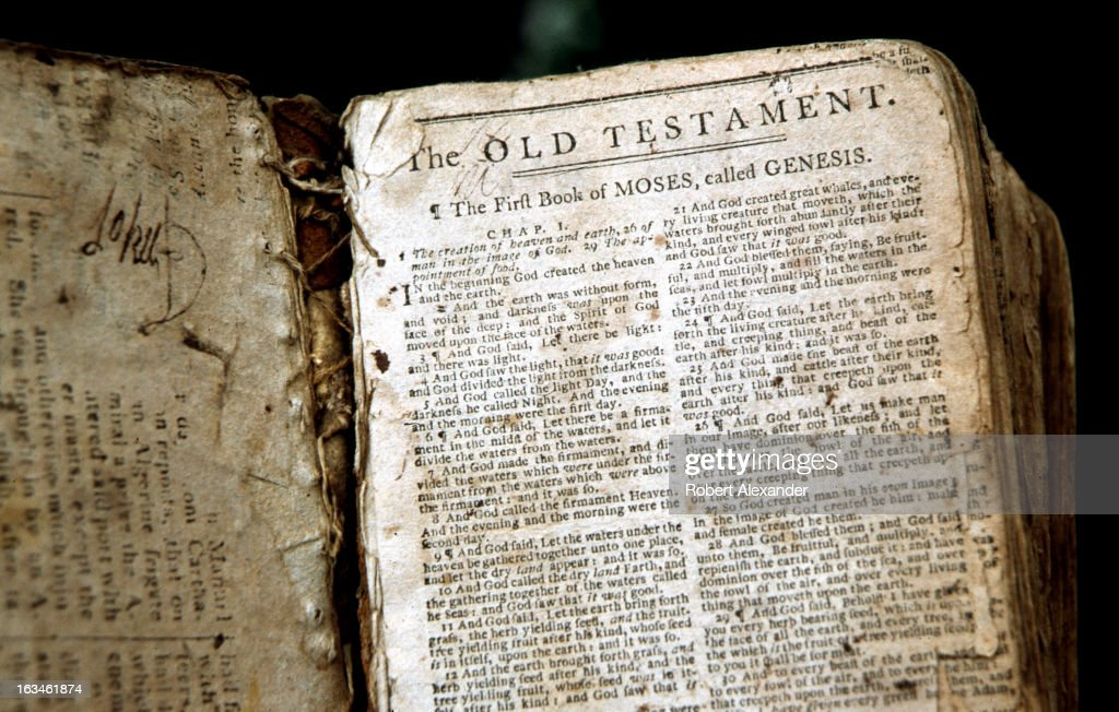 The first page of a well worn 18th Century family bible, opened to 'The First Book of Moses, called Genesis.' The Book of Genesis is the first book of the Christian Old Testament. (Photo by Robert Alexander/Archive Photos/Getty Images) 5104602RA_Alexander83.jpg