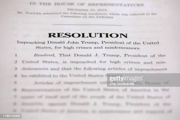 The first page of the House Judiciary Committee's two articles of impeachment against U.S. President Donald Trump is displayed in the Longworth House...