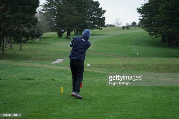 The first party of golfers return to playing at Falmouth Golf Club on March 29, 2021 in Falmouth, England. Today the government eased its rules...