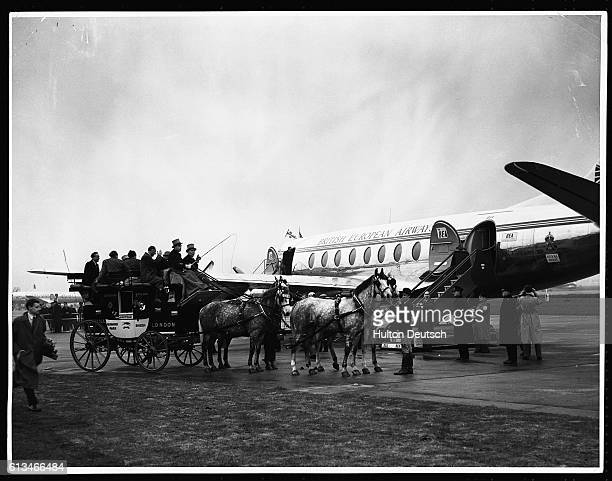 The first passengers of the Vickers Viscount 802 arrive via a horsedriven stagecoach The aircraft is the first of its kind to enter service with any...